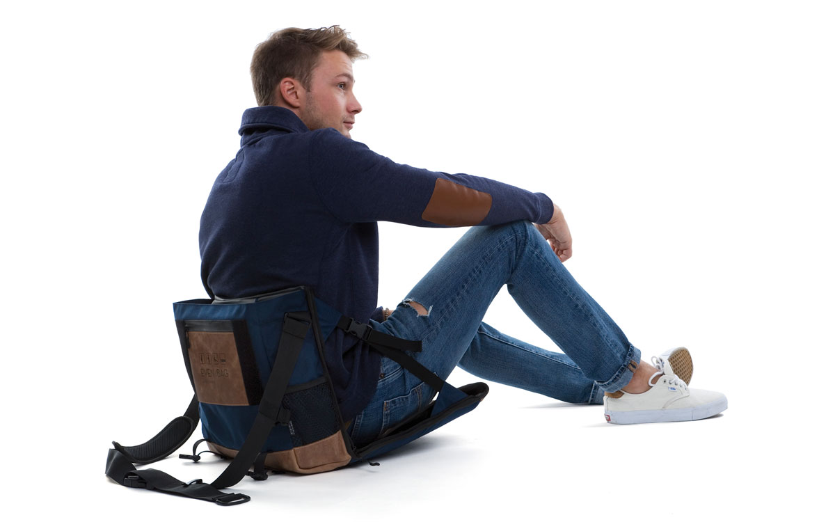 A fold up chair and computer bag