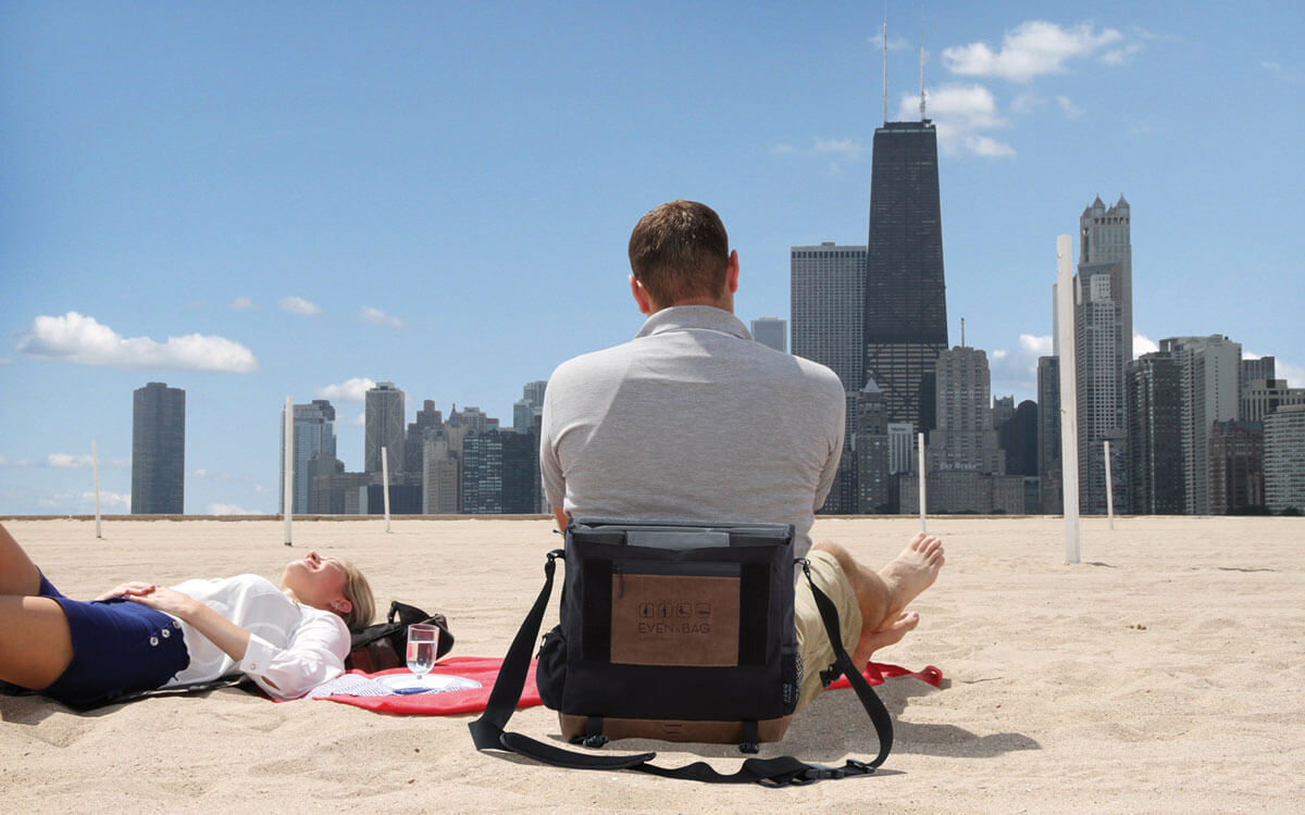 A picnic blanket and beach chair with Chicago Skyline