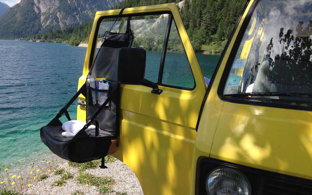 Hanging Toiletry bag with VW camper at a lake in the USA