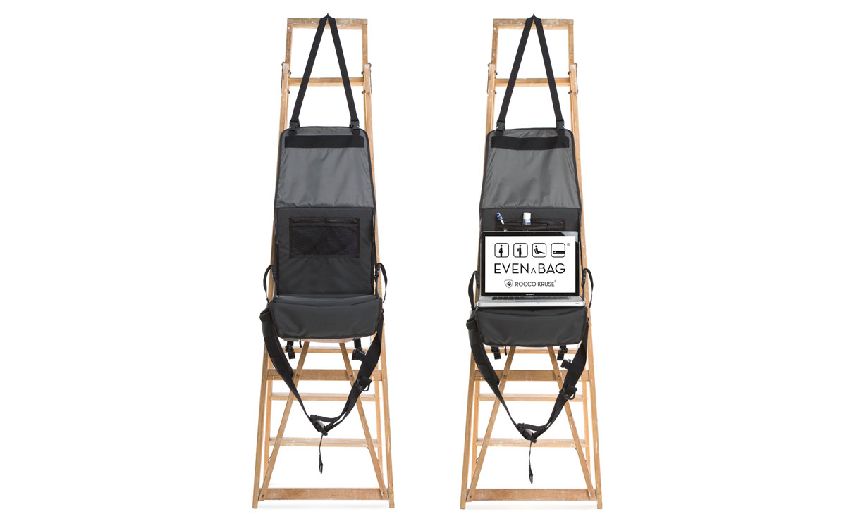 A versatile laptop work bag and toiletry bag hanging on a ladder