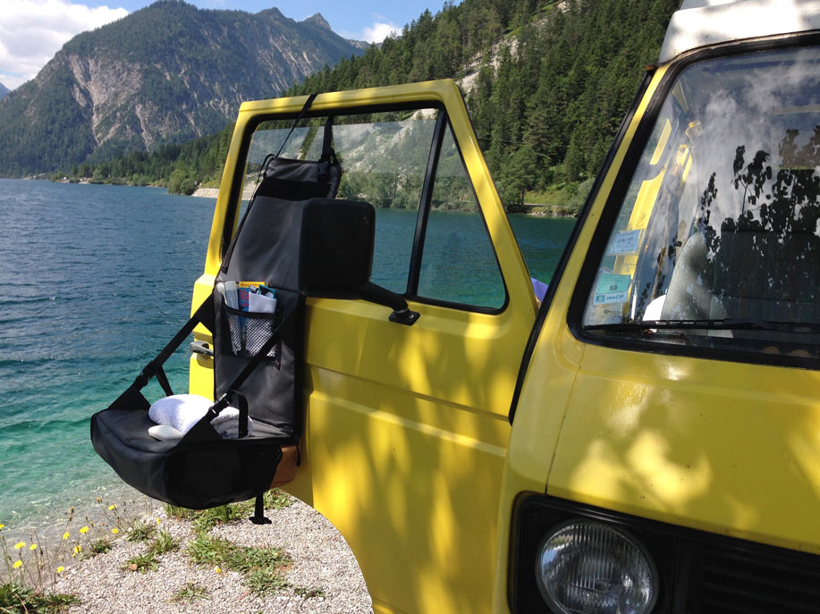 Camping wit Volkswagen bus and EVENaBAG toiletry bag at a mountain lake in USA